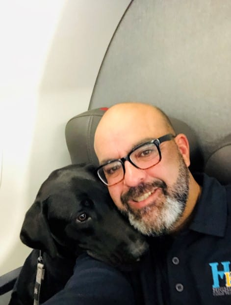 carlos hernandez with service dog on flight