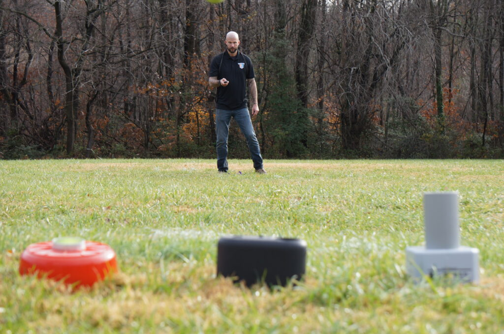 detection dog trainer conducting ball trainer study