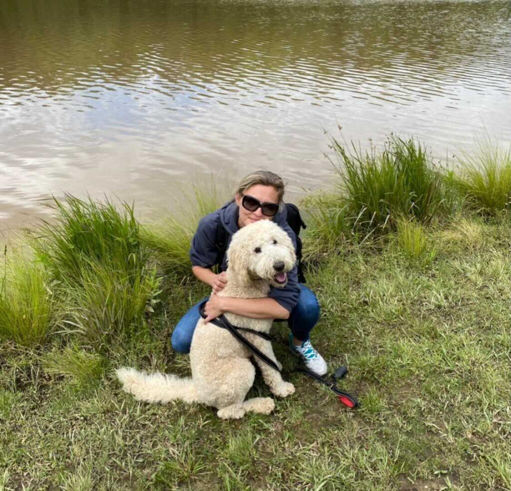 magdalena szymanska with dog near stream